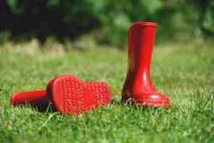 Child's red rubber boots 1 Royalty Free Stock Photography