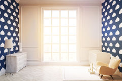 Child`s room with cloud wallpaper on dark blue wall, toned. Child`s room with a vertical framed poster, a cradle, an armchair and a toy horse. There is a large Stock Photography