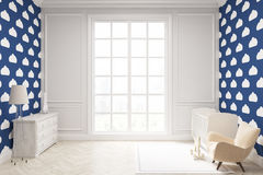 Child`s room with cloud wallpaper on dark blue wall. Child`s room with a vertical framed poster, a cradle, an armchair and a toy horse. There is a large window Royalty Free Stock Images