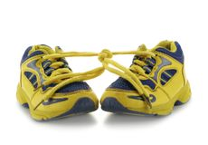 Child's running shoes. Child's yellow running shoes isolated over a white background stock photography