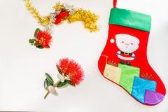 Child`s santa stocking with rd pohutukawa flower and tinsel simp Stock Image