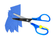 Child's scissors with blue scraps craft paper Royalty Free Stock Image