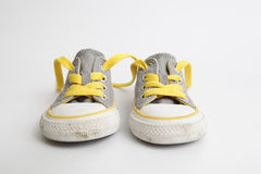 Child's Shoe. A fairly used child's shoe/sneakers isolated on white background - front view royalty free stock image