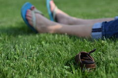Child's Shoe in Grass Stock Photos