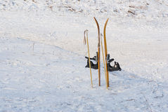 Child's skis stuck in to snow Stock Photo