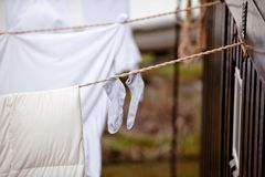 Child's socks and linen hanging Royalty Free Stock Photography