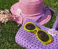 Child's Spring straw hat, purse and yellow sunglasses Royalty Free Stock Image