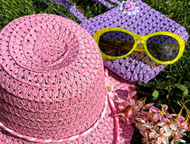 Child's Spring straw hat, purse and yellow sunglasses Stock Image