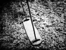 Child& x27;s swing in the snow. Swing covered in snow Royalty Free Stock Photo