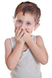 Child's Tantrum. Sad boy covers his mouth palms Stock Photos