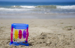 Child's toy on a beach. Colorful child's toy on a beach's sand by the ocean Stock Image