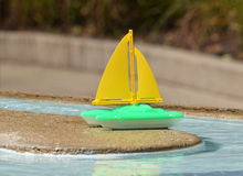 Childs toy boat  in a pool Royalty Free Stock Photo