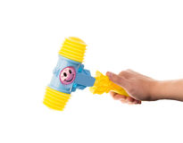 Child's toy hammer in hand Royalty Free Stock Photos