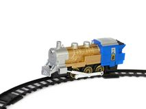 Child's toy, a locomotive on the rails, isolated Royalty Free Stock Photos