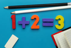 Child's toy number set, pencils and notebook. Royalty Free Stock Photography