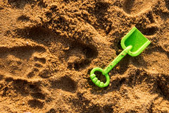 Child's toy on the sand - green shovel Stock Image