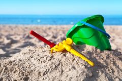 Childs Toys. On sandy beach, summer holidays concept stock photography