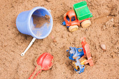Child's toys lie on sand. In a sand-box Royalty Free Stock Photo