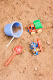Child's toys lie on sand Royalty Free Stock Image