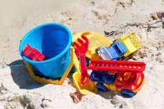 Child`s toys on sandy beach. Summer holidays concept Royalty Free Stock Images