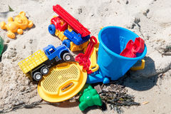 Child`s toys on sandy beach. Summer holidays concept Royalty Free Stock Photo