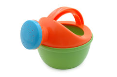 Child's watering-pot toy. Child's plastic watering-pot toy. Bright coloured Royalty Free Stock Photography