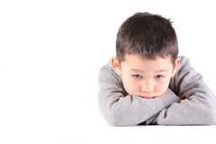 A child boy is sad, depressed, thinking something and not looking at the camera Stock Images