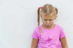 Child with sad expression Stock Photo
