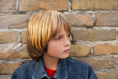 Child with sad face. Lonely boy stock photos