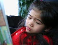 Child sadly reading a story Stock Photos