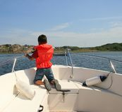 Child Safety. Photo of a 7 year old on a boat trip at sea, wearing a life vest. Child safety concept Stock Images