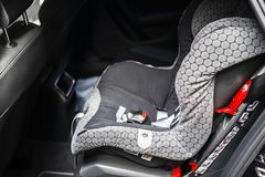 Child safety seat in the back of the car. Baby car seat for safety. Car interior. Car detailing. Child safety concept. Child safety seat in the back of the car stock photos