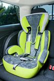 Child safety seat in car royalty free stock image