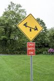 Child safety zone sign, yellow black, red white, icon see-saw stock photo