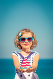 Child with sailing boat on summer vacation Royalty Free Stock Images