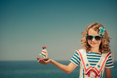 Child with sailing boat on summer vacation Royalty Free Stock Photography