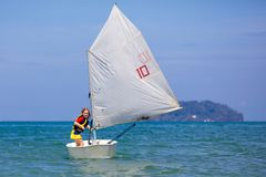 Child sailing. Kid learning to sail on sea yacht stock photos