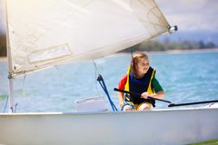 Child sailing. Kid learning to sail on sea yacht royalty free stock photo
