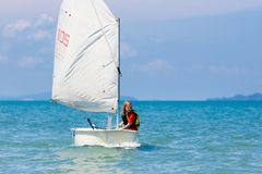 Child sailing. Kid learning to sail on sea yacht stock photo