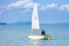 Child sailing. Kid learning to sail on sea yacht stock photography