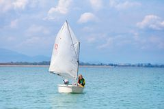 Child sailing. Kid learning to sail on sea yacht royalty free stock image