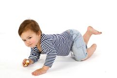 Child  in sailor's striped vest crawl Stock Images
