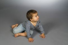 Child  in sailor's striped vest crawl Stock Photo