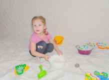 Child salt cave play hands prevention of the common cold. In the salt room baby girl looking at the camera Stock Photos