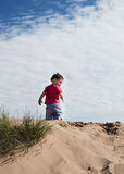 Child on sand dune Royalty Free Stock Photo