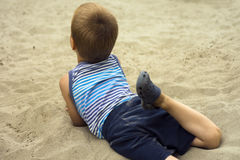 Child in sand Stock Photography