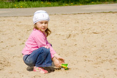 The child in sandbox. The child is played in a sandbox on a playground Royalty Free Stock Images
