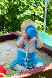 The child in the sandbox Stock Photography