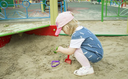 A child in a sandbox. A child playing in the sandbox close-up Royalty Free Stock Photos