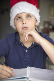 Child with Santa Claus hat Stock Photos